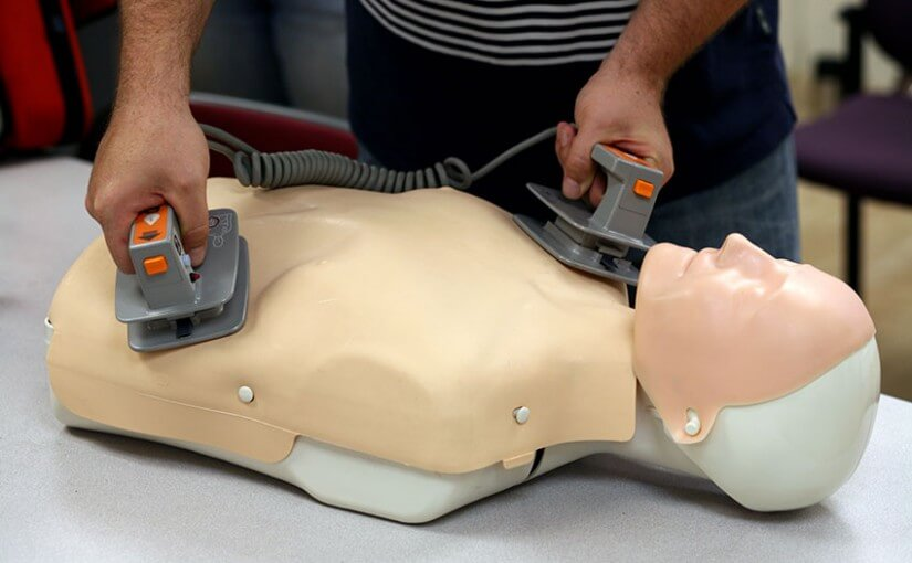 Man attemping to save a dying CPR dummy